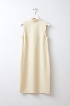 Togo Cream Oversized Dress with High Neck Sleeveless knee length ivory dress with a high neck and slit at the back from lovely Swedish brand Whyred.