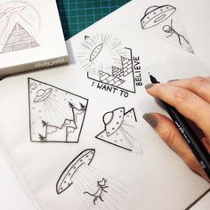 Working on a sheet of little alien tattoo designs. More of my tattoo…