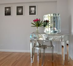 love this ghost chair with mirrored dressing table