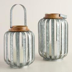 Handcrafted of mango wood and galvanized metal strips, our rustic lantern brings an industrial appeal to barbecues and summer gatherings.