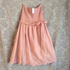 """Strapless Maurice's dress Never worn strapless dress with scalloped, eyelet detail at the hem. The shirt is a-line and hit right above my knee. I am 5'7"""" Maurices Dresses Midi"""