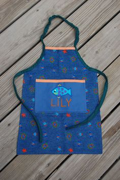 How to Sew an Elasticized Apron. The neck is elasticized so that it's easy to put on a child, but doesn't hang too long on top. What a great idea!