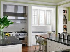 Kitche with lime green walls, white cabinets, dark countertops. Pop of color makes this exciting. Ideas for Brightening the Kitchen with Color on HGTV