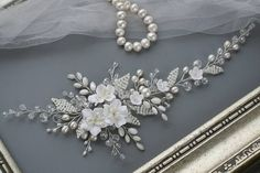 White Flower Bridal hair comb Wedding hair comb Flower Bridal hair accessories Bridal headpiece White Wedding hair accessories This is a new collection 2018. Stunning handicraft white bridal comb will decorate any brides hairstyle and looks good on both dark and fair hairstyle. Handcrafted