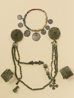 Viking age female burial assemblage with a pair of round brooches, chain… Medieval Jewelry, Viking Jewelry, Ancient Jewelry, Antique Jewelry, Viking Life, Viking Woman, Ancient Vikings, Norse Vikings, Viking Garb