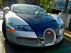 The Bugatti Grand Sport Bleu Nuit. 280 miles per Hour on the odometer. One car of a series of one for the sticker price of 2.7 Million Dollars