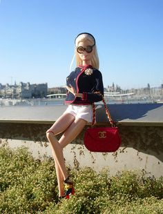 Port View outdoor photo of Barbie sporting her red Chanel bag