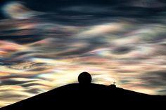 A nacreous cloud glistens over Antarctica