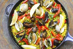 Paella is combination of social interaction with great food for a crowd. Seafood paella smothers rice with the flavor of the sea: fish, shrimps, mussels and clams, and aromatics. It's classic and flavorful.