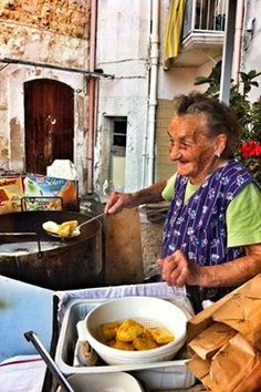 This is Maria, an old lady who makes the best Sgagliozze in Bari. She is about 85 and she cooks them in front of her house at the price of around 1-3 euros. She is a living legend and has been featured in Newsweek's 101 best places to eat street food in the world. Any baresi out there? www.panoramitalia.com