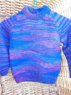 This sweater fits a 20 inch chest or a 1 year old and is knitted in multi colours of royal blue, maroon and grey. by Marionsknittedtoys on Etsy