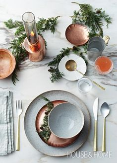 Beautiful holiday table setting with hammered copper plates and gold accents…