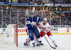 Maple Leafs vs. Red Wings - 01/01/2017 - Toronto Maple Leafs - Photos Danny DeKeyser #65 of the Detroit Red Wings defends Matt Martin #15