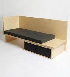 Purists might not approve, but the sanded unfinished plywood Stash Sofa (Urban Outfitters) with cushions and storage drawer offers a Judd-like look at a reasonable price.