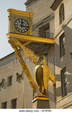 The Golden owl and golden clock outside Leeds Civic Hall. - Stock Image