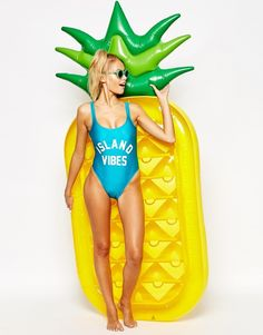 ::summer necessities include a super fun pool float. I'm loving this giant inflatable pineapple!::