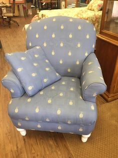 Pretty light blue chair with embroidered pineapples. Perfect sitting area for a bedroom or family room. $99