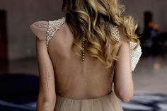 Sheer back. Pearlized sleeve. Soft tattoo on the arm. so chic.