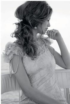 .The hair, the pearls, the dress. The earrings. What's she lost in thought about?