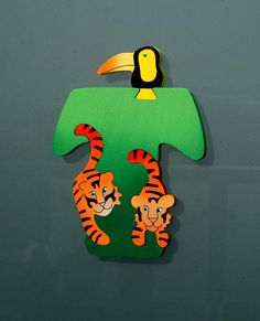 T is for tiger, tucan, Tanya and Tommy.  Unique in their genre our handmade wooden wall letters are both an attractive room decoration and a jigsaw puzzle which can be taken down, played with, and put away again on the wall. As a decoration they make a great gift for Christening too.  Our puzzles are made from European birch plywood and the child friendly colours are manufactured in England and conform to European Safety Standards.