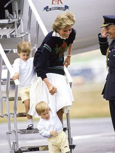 """Diana helps her matching towheaded sons William, 4, and Harry, nearly 2, navigate a safe landing at the Aberdeen Airport, where the family headed for a summer vacation in 1986. """"It would have been a little tricky if it had been two girls,"""" Diana told the BBC. """"William's future being as it is, and Harry like a form of a back-up in that aspect."""""""