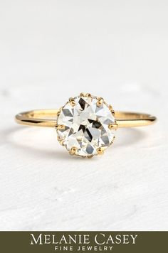 A round cut diamond focal is set in a six-prong setting, with a hidden halo of white diamonds set between the prongs. The delicate band is 14k gold, available in yellow, rose, or white. Create your own Touchpoints Ring with a focal diamond from our Choose Your Stone collection at melaniecasey.com! The pictured center stone is a 1.69ct. antique cut diamond. Thing 1, Dream Ring, Diamond Gemstone, Round Cut Diamond, Halo, Delicate, Engagement Rings, White Diamonds, Gemstones