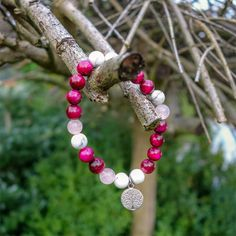 This gemstone pink Tiger's Eye bracelet with Howlite, Rose Quartz and Tree of Life charm is one of our favourite ones.