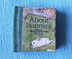 Dolls House Miniature About Bunnies Illustrated Book - Over 10,000 other miniature dollshouse items in stock! Visit www.thedollshousestore.co.uk