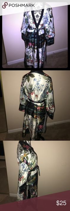 Colorful kimono Garden and flower patterned long kimono with side slits and satin belt to match. NWT. Size small but is oversized and can fit a large Tops