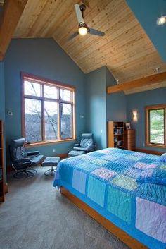 timber frame home blue bedroom