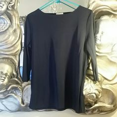 Apostrophe Navy 3/4 Sleeve Top This top is great for work or casual. Can be dressed up or down. Nice material that does not easily wrinkle. 70% poly, 30% rayon. Great for travel, no iron needed. Dark navy, 3/4 sleeve. Apostrophe  Tops Blouses