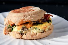 Breakfast Sandwiches Quiche Pattie: 2 tablespoons butter 1 medium onion, diced 8 ounces button mushrooms, sliced thin 2 tablespoons olive oil Salt and pepper, to taste 1-10 ounce package frozen chopped spinach, defrosted and squeezed dry 10 eggs 1-1/2 cup milk.