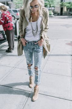 Pair the Surge tank in white, layered over the Speed bra with boyfriend jeans, wedge booties, a statement necklace and a light jacket for these cooler temps. Fall 2015.