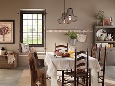 A subtle tone—Behr's Eiffel for You— transforms this dining room into a countrified retreat.