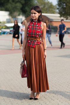 Milan Fashion Week spring 2014, Street style. Miroslava Duma in asymmetric, buttoned tartan top, orange melon Céline skirt.