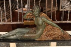"""Demetre H. Chiparus, """"Bles"""", bronze figure of a young girl with a wheat garland, green and gold patinated bronze raised on a black marble base, signed. Ref. in Alberto Shayo catalogue, p. 204, 136 Height: 12.5"""