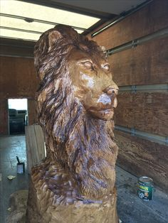 Lion by Jacob Frenette chainsaw carving.