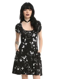 """Reach for the stars by wearing this black and white dress! The fit and flare dress has an allover constellation print, flattering fitted stretch waistband, cap sleeves and a keyhole back detail. Perfect for aspiring astronomers or a casual date night look.    95% rayon; 5% spandex  Wash cold; dry flat  Size small approx. 33"""" from shoulder to hem  Model is wearing size small  Imported"""