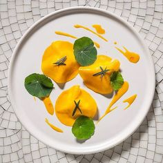 Vermont burrata covered in butternut squash carpaccio with nasturtium by @andrewcarmellini of @littleparknyc, at Smyth in TriBeCa, NYC. #TheArtOfPlating