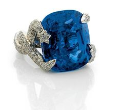 CHANEL, An important cushion cut sapphire set within two twisted snakes and set with brilliant cut diamonds. Sapphire : 58,53cts.    By a Gubelin report, stating that the sapphire is of Burmese origin (MYANMAR), with no indications of heating,and that this sapphire has a perfect colour saturation and a high degree of transparency' and that such a sapphire is considered to be extremely rare.   This 'Chanel' ring is the most important sapphire ring ever been proposed for sale at auction.