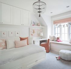 Completely adorable girl's room with soft coral hues by Kelly Deck