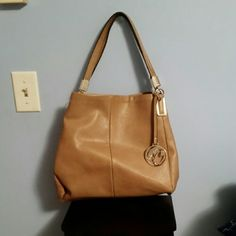 Camel handbag Cute camel colored handbag by Carolyn Tucker, in excellent condition. Has three inside openings. The middle one zips, and two others button Carolyn Tucker Bags Satchels