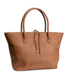 Product Detail   H&M US Handbag in grained imitation leather with double handles, zip and tie at top, and two inner compartments. Lined. Size 11 3/4 x 17 3/4 in.