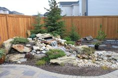 Pondless waterfall - Outdoor retreat - modern - landscape - calgary - by Spring Meadows Landscaping Ltd. Landscaping Calgary, Pond Landscaping, Modern Landscaping, Backyard Water Feature, Ponds Backyard, Backyard Pergola, Backyard Waterfalls, Pergola Kits, Patio