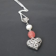 Peach tourmaline, pearl and tibetan heart charm necklace £9.00