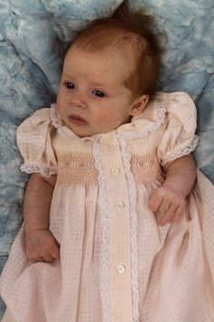 """Ms. Dot made this beautiful """"Precious Pink"""" swiss dimity voile windowpane daygown.  The pattern is Smocked Baby Clothes by Old Fashioned Baby and the embroidery design came from Jeannie B's Book."""