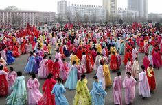 North Korean students dance to celebrate the 69th birthday of their leader, Kim Jong Il, in the North Korean capital of Pyongyang. (KCNA via AP)