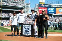 After serenating Mariano Rivera with 'Enter Sandman,' Metallica poses for pictures with the man of the hour at Yankee Stadium.