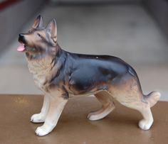 Vintage Japanese-made porcelain figurine of a German Shepard. Perfect condition. Nice size. Great pose. by hazelhome on Etsy https://www.etsy.com/listing/229166601/vintage-japanese-made-porcelain-figurine