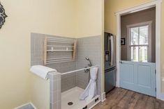 dog washing station in laundry room with shower curtain rod as splash barrier. Metal Barn Homes, Metal Building Homes, Pole Barn Homes, Building A House, Laundry Room Storage, Laundry Room Design, Shower Storage, Dog Tub, Dog Washing Station